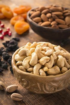 Variety of nuts and dried fruits by The baking man on Creative Market