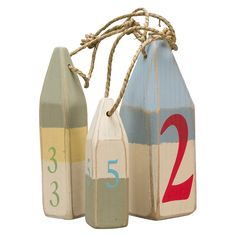 Wood Buoy. Add a nautical element, in soft soothing coastal colors for your indoor or outdoor space. Hand-painted wood buoys are given a rubbed edge detail for a weathered style. Place on a tabletop or hang on the wall.