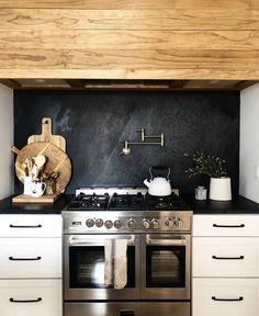 Kitchen with slate backsplash + wood range hood + white cabinets # design Kitchen Hoods, New Kitchen, Kitchen Dining, Kitchen Decor, Kitchen Cabinets, White Cabinets, Dark Kitchen Countertops, Slate Kitchen, Kitchen Soffit