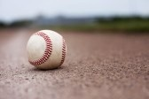 A ball lying on the infield of a baseball field. Shallow depth of field.  stock photography