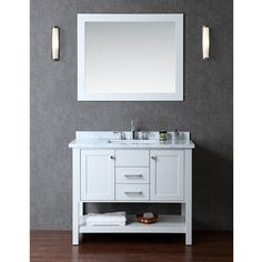 """The cloud grey finish on this 42"""" vanity is stunning and pairs marvelously with the white carrera marble countertop. Two doors and two sliding drawers provide generous storage space for all your bathroom essentials."""