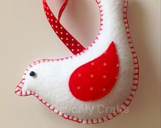 This pretty felt dove is designed and hand stitched by Devonly Crafts in the beautiful county of Devon. It is made with acrylic felt and is completely handstitched with love and care. It is stuffed with enough polyester filling to make it plump and has. Christmas Stockings, Christmas Wreaths, Christmas Crafts, Christmas Decorations, Christmas Ornaments, All Things Christmas, Christmas Holidays, Felt Ornaments, Hand Stitching