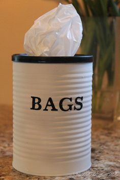 store your extra plastic bags neatly in this recycled coffee can!