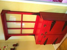 """Re-purposed dresser into a """"hutch"""".  Attached is a old vintage window and a shelf added to the top. Accented w/ old rusty barn hinges that have been clear coated."""