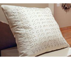 Braille Pillow   - 2007, hand embroidery on cotton, down pillow. Collection of the Jenny Hart, of Sublime Stitching.  (This is a cool idea as it is tactile + still attractive done w/ French knots + border around pillow's edge.  I wonder what it says?