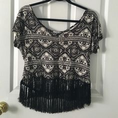 Black & White Aztec Top with Fringe Bottom Aztec design with fringe bottom. Wide neck and short sleeve. Black & white. Back is a little longer than the front. *tag is missing for the size but it is a small/medium (more of a medium) Charlotte Russe Tops