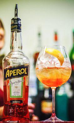 Aperol Spritz Cocktail Recipe:  2 oz Prosecco 1 1/2 oz Aperol 3/4 oz Soda  Glass: Rocks/Wine Glass Method: Build Ice: Cubed Garnish: Orange Slice or Zest