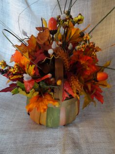 Fall multicolored wooden basket containing silk flowers, berries, leaves.  Wonderful Fall arrangement for your home!  $25.00