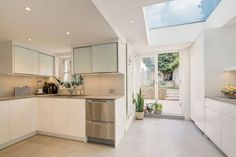 Large skylight enlivens the new kitchen space of the London home