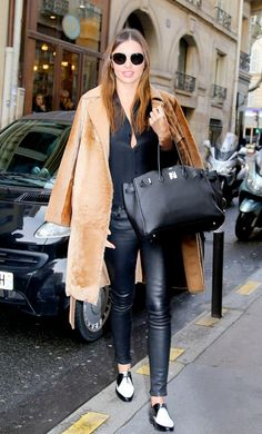 Miranda Kerr opted for a fur oversized coat, cropped leather pants, and patent leather oxfords