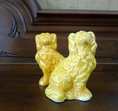 Pair of petite English Staffordshire spaniels in yellow glaze.