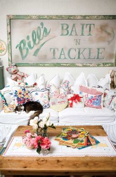 Nice display of repurposing vintage linens into pillows,