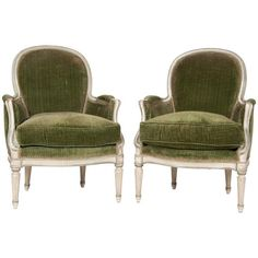 """A pair of painted and upholstered Louis XVI style armchairs with down cushions attributed to Jansen. Circa Mid 20th Century. Seat height : 20"""" high.  35.5 H x 26 W x 32 D"""