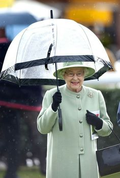 Queen Elizabeth II celebrates her 86th birthday in the rain while attending the Dubai Duty Free Day at the Newbury Racecourse.  April 21, 2012.