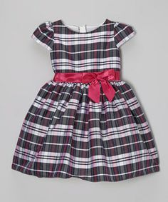 For a look that's both captivating and comfy, this dress is the perfect fit with its bright bow, classic plaid and roomy skirt. A zippered back makes transforming into a pretty princess an effortless endeavor.