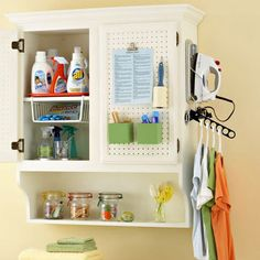 Laundry Room: On Cabinet, a collapsible clothes rod is attached and iron is wall mounted as well. Like the idea of peg board cabinet fronts in laundry room. Clothes Rod, Laundry Cabinets, Laundry Cupboard, Laundry Room Organization, Laundry Rooms, Laundry Area, Laundry Closet, Laundry Tips, Ideas Para Organizar