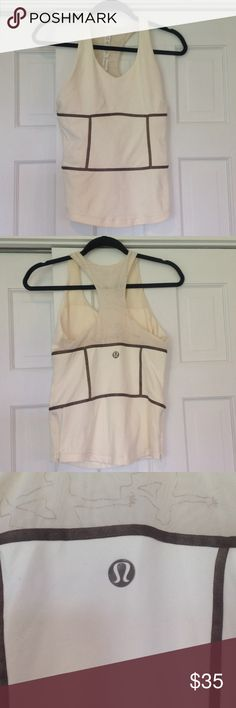 Lululemon built in bra tank sz 8 ☀️ Guc lululemon cream tank with brown panel accents.  Size 8 built in bra and zippers on sides below brown bottom panel lululemon athletica Tops Tank Tops