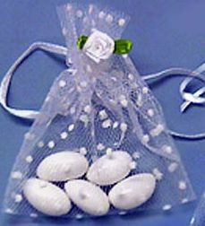 Italian tradition; At traditional Italian weddings, five almonds signify five wishes for the bride and groom: health, wealth, happiness, fertility, and longevity. These almonds decorate each place setting as favors, tucked into pretty boxes or tulle bags called bomboniere that are often personalized with the couple's names and wedding date.