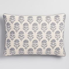 Glinting with hints of silver thread and bordered with gray piping detail, our lumbar pillow's embroidered Samode motif conjures India's age of maharajas.