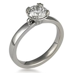 Carved Leaf Engagement Ring - The ultimate in simple elegance, this unique solitaire engagement ring showcases the side of the diamond within the organic, carved detailing of the prongs. 3mm wide.