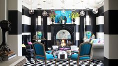 Inside Kourtney Kardashian's Living Room // Black and white walls with turquoise accents