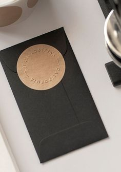 mini black envelope with kraft seal