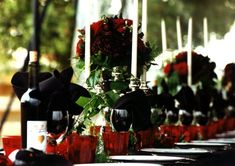 Beautiful and dramatic Gothic Halloween wedding table decor.