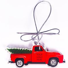 Have your logo printed in full-color on these wooden (made from Birch) classic red trucks carrying a Christmas tree. 50 piece minimum order. Also available as acrylic ornaments. Only 2-week production time! These make great Christmas gifts for your clients and employees!