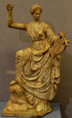 Muse terracotta statuette from Tanagra - circa 3th c. B.C - at the Hermitage Museum, Petersburg