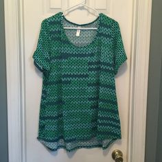 NWOT LuLaRoe XXL Classic t in green print SOLD NWOT LuLaRoe XXL Classic t in green knit print. Never worn or washed LuLaRoe Tops Tees - Short Sleeve