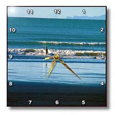The Deep Blue Water with a Surfer Walking out to Sea with His Surf Board Wall Clock