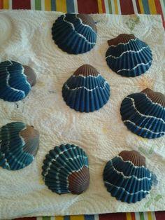 Painting seashells to make Xmas ornaments.