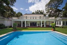 A spacious pool is the jewel of this Florida home's backyard. Cherokee by Phil Kean Designs