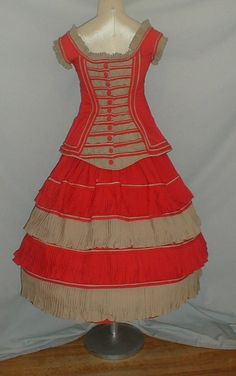 "Glorious 1850-1860 Young Ladies Tan Red Wool Dress | eBay seller fiddybee; hand stitched, bodice elaborately ruched, neck & armscyes trimmed w/ ruffles, rows of orange/red and tan padded cording, front pockets trimmed w/ decorative buttons, bodice lined w/ cotton, skirt lined w/ polished cotton; bust: 30""; waist: 28""; skirt length: 28""; width at hemline: 84"""