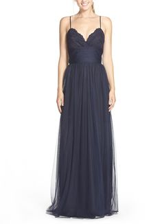 Delicate straps and a romantic silhouette make this bold navy gown stand out with elegance.
