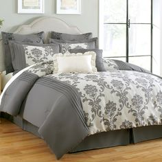This comforter features a beautiful jacquard design sure to enhance your bedroom decor. With euro shams, decorative pillows, pillow shams and a tailored bed skirt in addition to a stylish, reversible comforter, this set has everything you need.