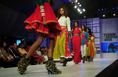 Models present creations by Pakistani designer on April 9, 2012 on the third day of the Fashion Pakistan Week in Karachi.