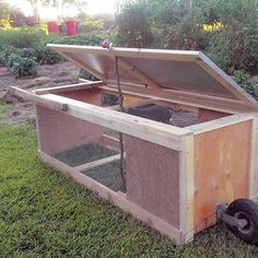 Homestead Hacks: DIY Rabbit Tractor TSC carries canine and pet cages, crates, kennels, runs, fencing and enclosures for large and small casting off for sale at your local Tractor Supply store. Dog House With Porch, Build A Dog House, Rabbit Farm, House Rabbit, Rabbit Cages Outdoor, Raising Rabbits, Cool Dog Houses, Mother Earth News, Rabbit Hutches