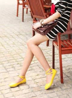 Love the yellow shoes. They almost look like ballet slippers and they're such a nice pop of color with a black and white dress.