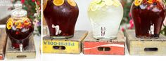 Beverage Dispensers on top of soda crates - easy and cute!