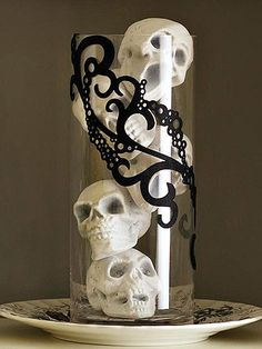 Spook your guests with this eerie skull arrangement. More Halloween decorations: http://www.bhg.com/halloween/indoor-decorating/spell-binding-halloween-decorations/?socsrc=bhgpin101413skulls&page=10