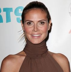 Heidi Klum wears a sleek ponytail hairstyle