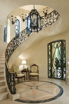 Mediterranean Staircase with Cathedral ceiling, Wall sconce, Jensen Design Custom Rail, Stone Pride Medallion, French doors # stairs # doors # windows Foyer Staircase, Staircase Design, Entryway Stairs, Curved Staircase, Spiral Staircases, Villa Plan, Future House, My House, Stair Railing
