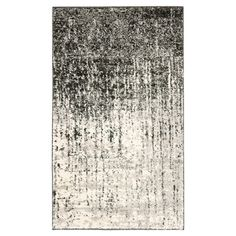 Ombre rug.  Product: RugConstruction Material: PolypropyleneColor: Black and greyFea...