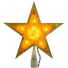 The gold edge on this star tree topper locks in the light and the color!