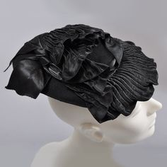 Flat hat toque or topper from the 1940's (side view)   Label: Muhlfelder   Sometimes called an Eleanor Roosevelt hat as she wore this style quite a lot