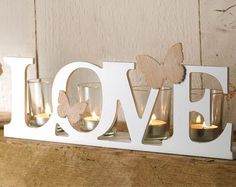Pretty 'Love' candle holder with sweet little butterfly detail, holds 4 candles with glass holder included. x x - tea lights not included. Glass Holders, Tealight Candle Holders, Tea Lights, Wall Lights, Tea Light Holder, Beautiful Bathrooms, Candle Sconces, Home And Living, Home