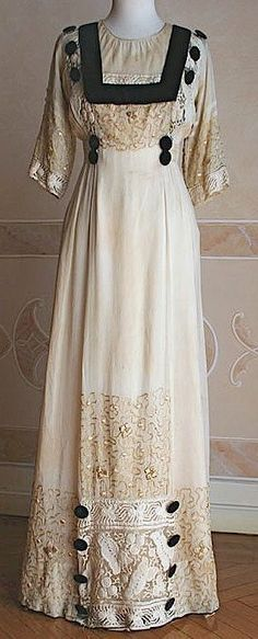 1909 ~ Edwardian Day Dress in Ivory Silk with Black Velvet Trimmings & Buttons, Lace Panels to the Front, Hem & on Sleeves ....