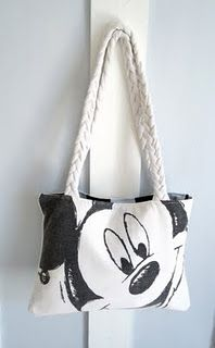 I have to learn how to do how to do this t-shirt bag. My best friend would love this she is crazy for all things disney
