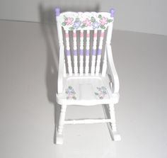 Hand-Painted, Miniature Dollhouse Furniture. Brand New. Pink and purple flowers hand-painted on white rocking chair. Not fussy - just simple and sweet. 1:12 One-inch scale dollhouse furniture. Collectible dollhouse furniture - not intended for children under 14.  Sweet and pastel - truly an attractive piece for a little girls room in your dollhouse - a great accent piece.  One-inch scale furniture. Hand-painted - no stencils, no decals. Signed by the artist. IN STOCK READY TO SHIP  Custom…